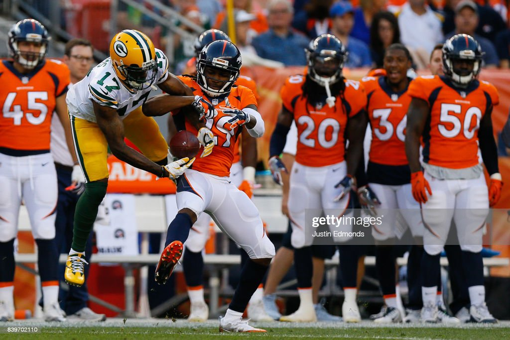 Wide receiver Davante Adams #17 of the Green Bay Packers battles for a pass with cornerback Bradley Roby #29 of the Denver Broncos in the first quarter of a Preseason game at Sports Authority Field at Mile High on August 26, 2017 in Denver, Colorado.