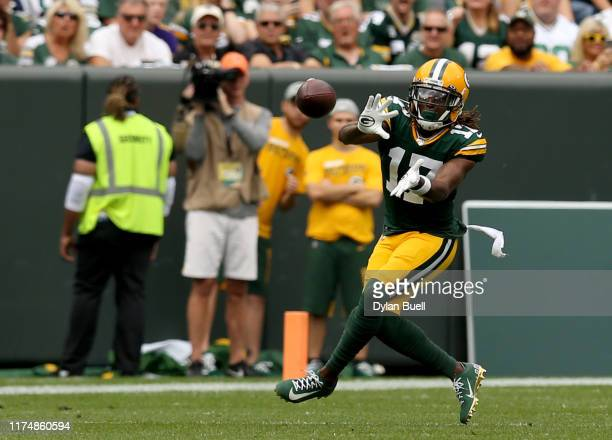 Wide receiver Davante Adams of the Green Bay Packers catches a pass against the Minnesota Vikings in the game at Lambeau Field on September 15 2019...