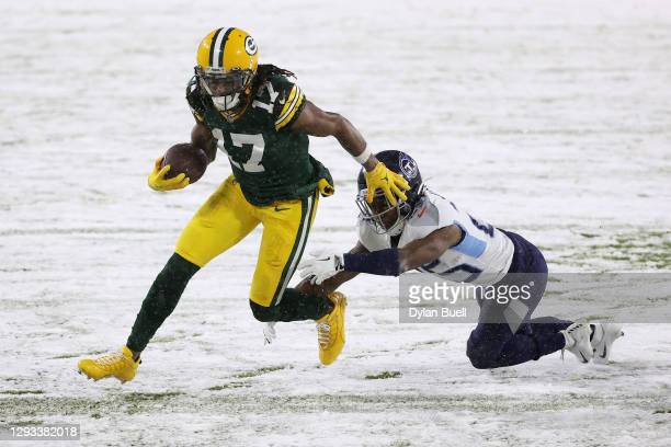 Wide receiver Davante Adams of the Green Bay Packers runs for a touchdown against cornerback Adoree' Jackson of the Tennessee Titans during the first...