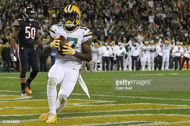 Wide receiver Davante Adams of the Green Bay Packers scores a fourth quarter touchdown past inside linebacker Jerrell Freeman of the Chicago Bears at...
