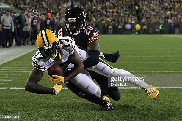 Wide receiver Davante Adams of the Green Bay Packers scores a third quarter touchdown against cornerback DeVante Bausby of the Chicago Bears at...