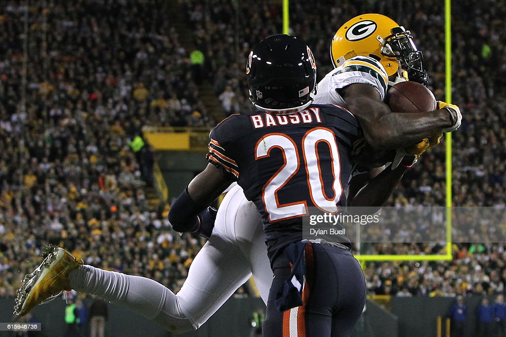 Wide receiver Davante Adams #17 of the Green Bay Packers scores a third quarter touchdown against cornerback DeVante Bausby #20 of the Chicago Bears at Lambeau Field on October 20, 2016 in Green Bay, Wisconsin.