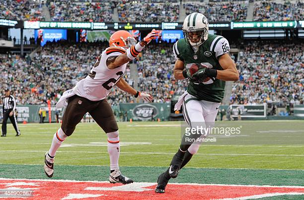 Wide receiver David Nelson of the New York Jets scores a touchdown against Buster Skrine of the Cleveland Browns in the second half at MetLife...