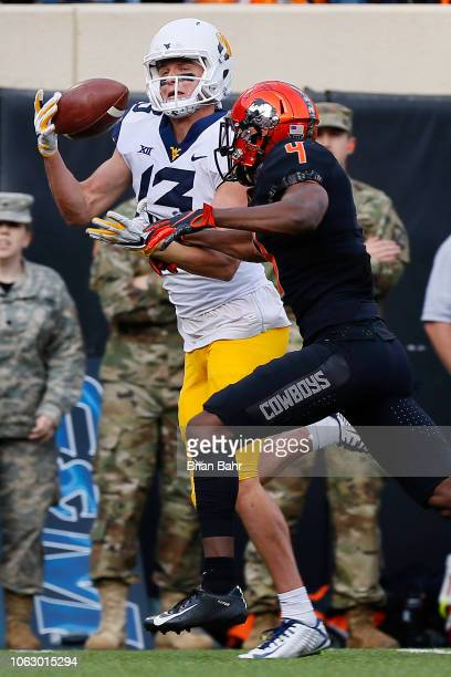 Wide receiver David Sills V of the West Virginia Mountaineers catches a pass for a touchdown against cornerback AJ Green of the Oklahoma State...
