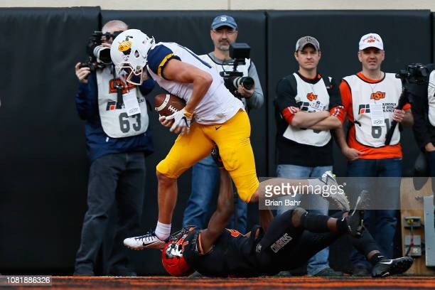 Wide receiver David Sills V of the West Virginia Mountaineers holds onto a 22yard touchdown catch against cornerback AJ Green of the Oklahoma State...