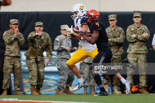 Wide receiver David Sills V of the West Virginia Mountaineers pulls in a 22yard touchdown catch against cornerback AJ Green of the Oklahoma State...