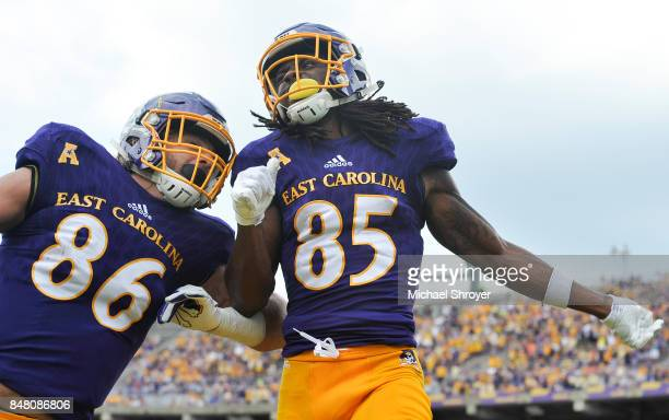 Wide receiver Davon Grayson of the East Carolina Pirates celebrates his touchdown reception with tight end Stephen Baggett in the first half at...