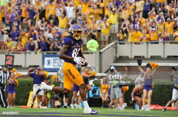 Wide receiver Davon Grayson of the East Carolina Pirates scores a touchdown against the Virginia Tech Hokies in the first half at DowdyFicklen...