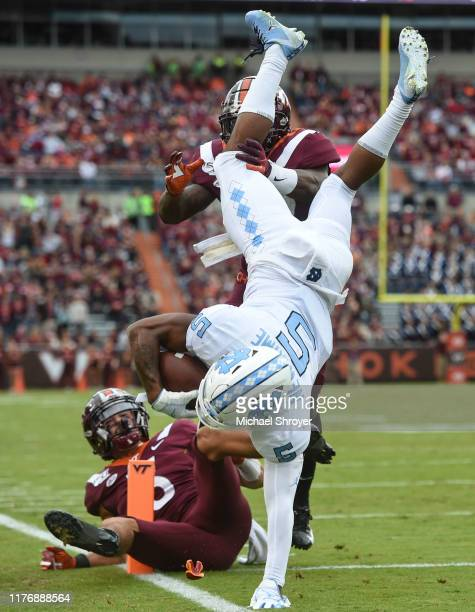 Wide receiver Dazz Newsome of the North Carolina Tar Heels scores a touchdown against the Virginia Tech Hokies in the first half at Lane Stadium on...