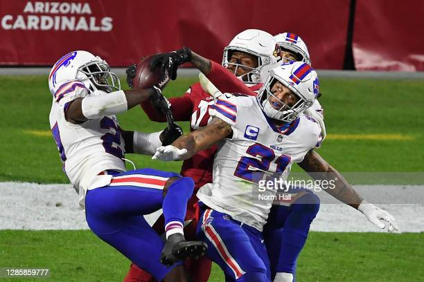 Wide receiver DeAndre Hopkins of the Arizona Cardinals catches the game-winning touchdown pass as safety Jordan Poyer and safety Micah Hyde of the...