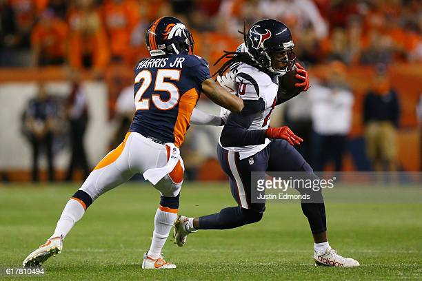 Wide receiver DeAndre Hopkins of the Houston Texans is pushed out of bounds by cornerback Chris Harris of the Denver Broncos in the first quarter of...