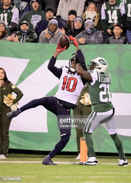 Wide receiver DeAndre Hopkins of the Houston Texans makes a catch to score the game-winning touchdown against cornerback Morris Claiborne of the New...