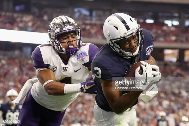 Wide receiver DeAndre Thompkins of the Penn State Nittany Lions catches a 34 yard reception past defensive back Austin Joyner of the Washington...