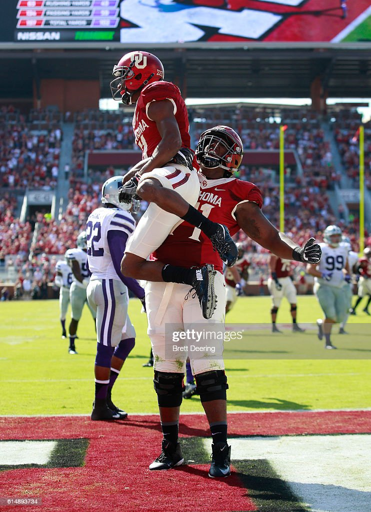 Wide receiver Dede Westbrook #11 and offensive lineman Bobby Evans #71 of the Oklahoma Sooners celebrate a touchdown against the Kansas State Wildcats October 15, 2016 at Gaylord Family-Oklahoma Memorial Stadium in Norman, Oklahoma. Oklahoma defeated Kansas State 38-17.