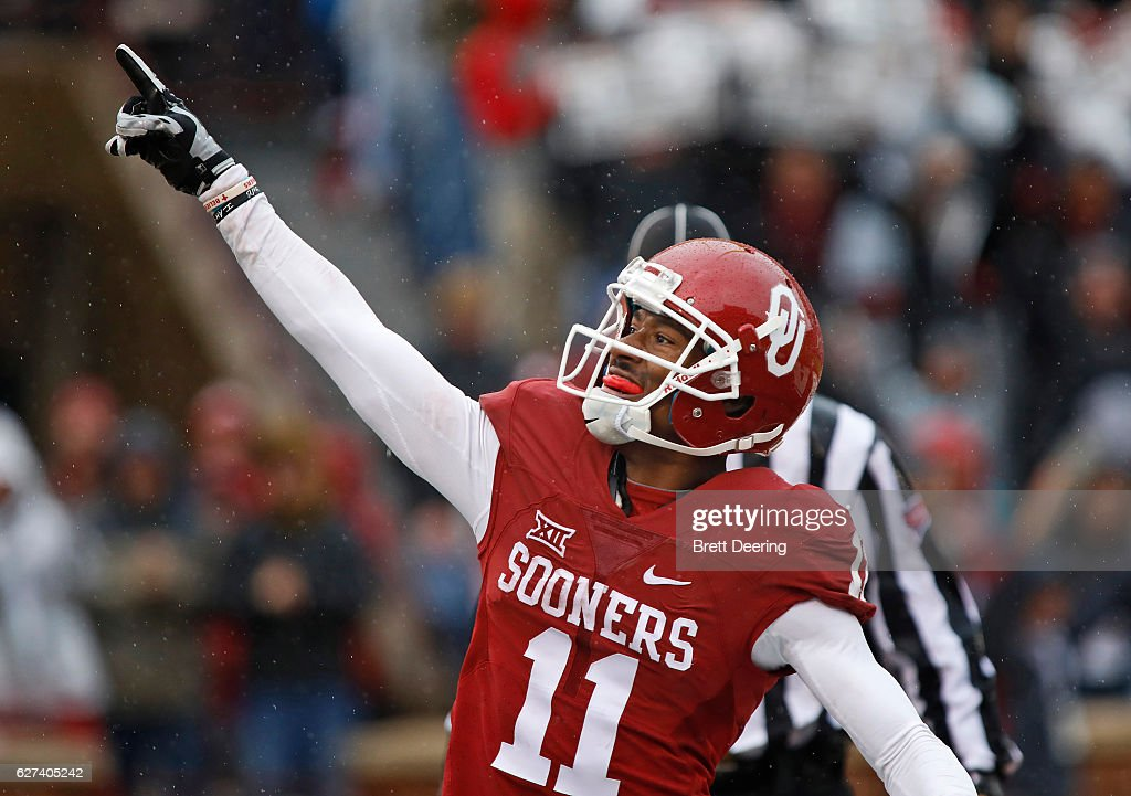 Wide receiver Dede Westbrook #11 of the Oklahoma Sooners celebrates a touchdown against the Oklahoma State Cowboys December 3, 2016 at Gaylord Family-Oklahoma Memorial Stadium in Norman, Oklahoma.