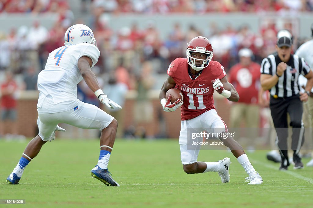 Wide receiver Dede Westbrook #11 of the Oklahoma Sooners puts a move on cornerback Brodrick Umblance #4 of the Tulsa Golden Hurricane at Gaylord Family Memorial Stadium on September 19, 2015 in Norman, Oklahoma.