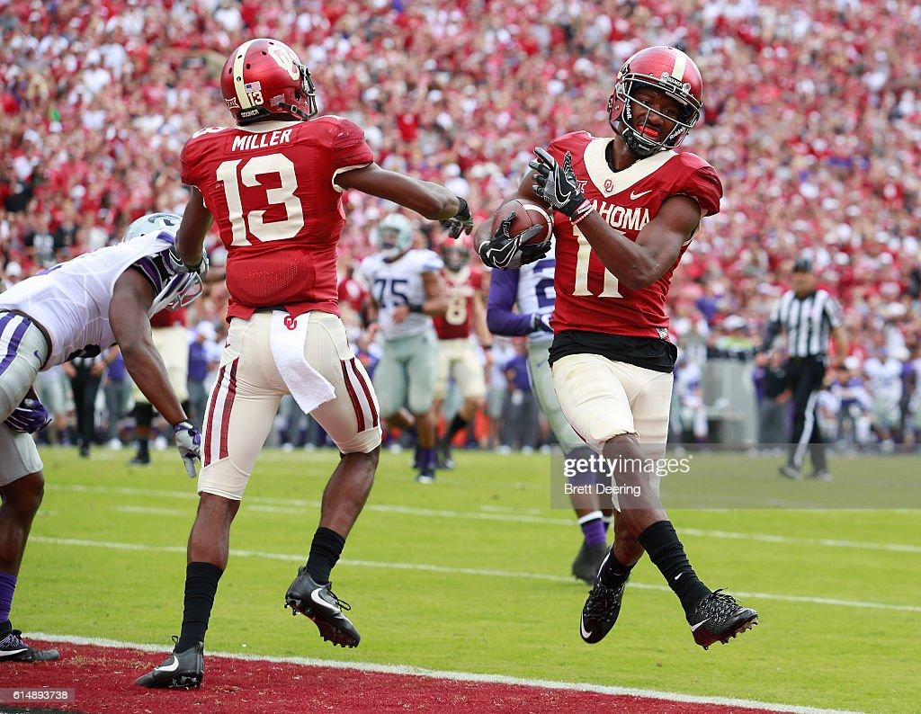 Wide receiver Dede Westbrook #11 of the Oklahoma Sooners scores against the Kansas State Wildcats October 15, 2016 at Gaylord Family-Oklahoma Memorial Stadium in Norman, Oklahoma. Oklahoma defeated Kansas State 38-17.