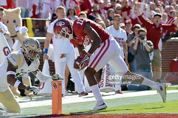Wide receiver Dede Westbrook the Oklahoma Sooners scores a touchdown in front of safety Chance Was of the Baylor Bears on November 12, 2016 at...