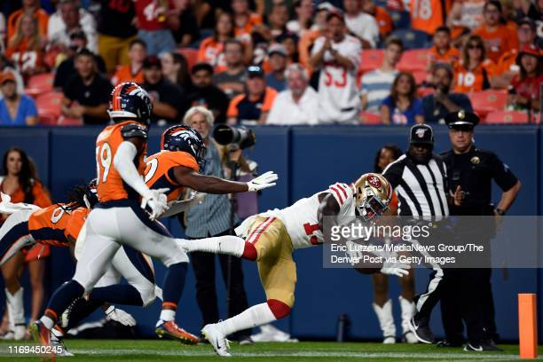 Wide receiver Deebo Samuel of the San Francisco 49ers comes up just short of the goal line setting up a first and goal touchdown during the third...