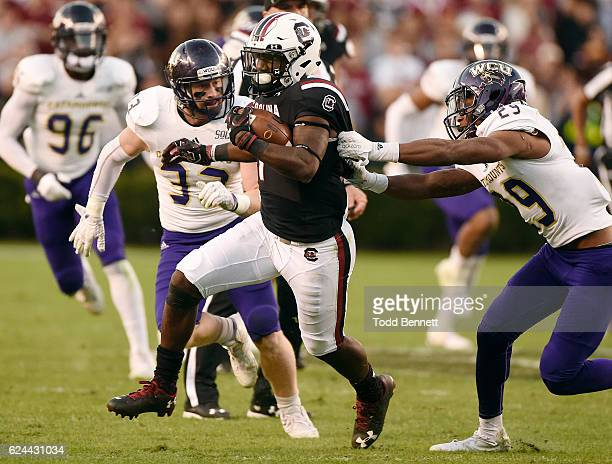 Wide receiver Deebo Samuel of the South Carolina Gamecocks breaks a tackle by defensive back Marvin Tillman of the Western Carolina Catamounts on...