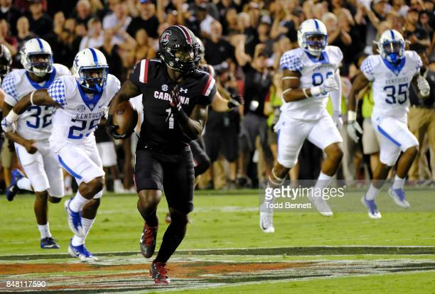Wide receiver Deebo Samuel of the South Carolina Gamecocks outruns defenders from the Kentucky Wildcats for a touchdown at WilliamsBrice Stadium on...