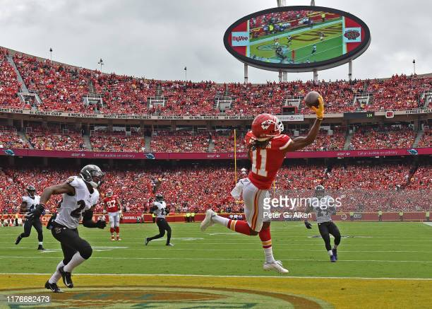 Wide receiver Demarcus Robinson of the Kansas City Chiefs catches a touchdown pass against cornerback Brandon Carr of the Baltimore Ravens during the...
