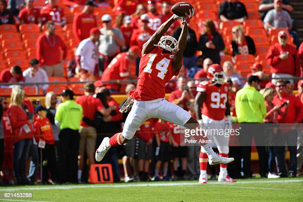 Wide receiver Demarcus Robinson of the Kansas City Chiefs catches a pass during warm ups before the game against the Jacksonville Jaguars at...