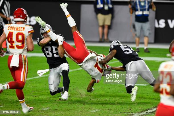 Wide receiver Demarcus Robinson of the Kansas City Chiefs is tackled by tight end Derek Carrier and middle linebacker Raekwon McMillan of the Las...