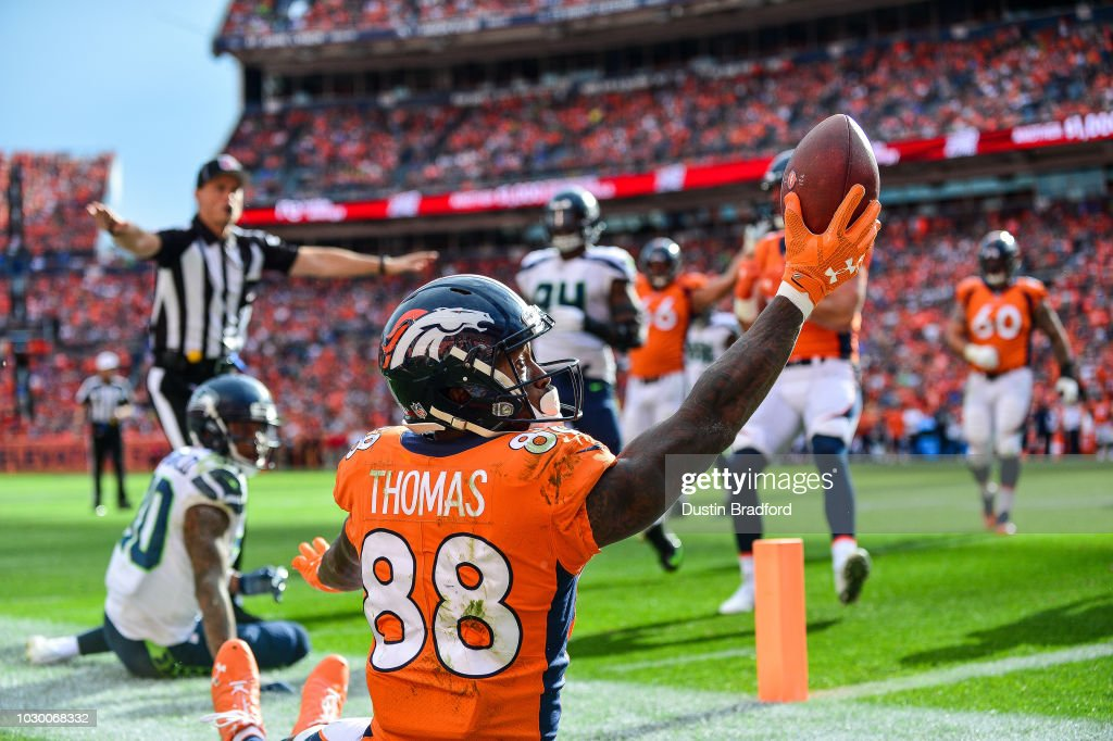 Wide receiver Demaryius Thomas #88 of the Denver Broncos appeals to the referee for a touchdown call after making a catch on the edge of the end zone against the Seattle Seahawks at Broncos Stadium at Mile High on September 9, 2018 in Denver, Colorado. The catch was ruled a touchdown.
