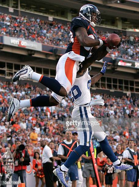 Wide receiver Demaryius Thomas of the Denver Broncos battles in the air with cornerback Kelvin Hayden of the Indianapolis Colts during NFL action at...