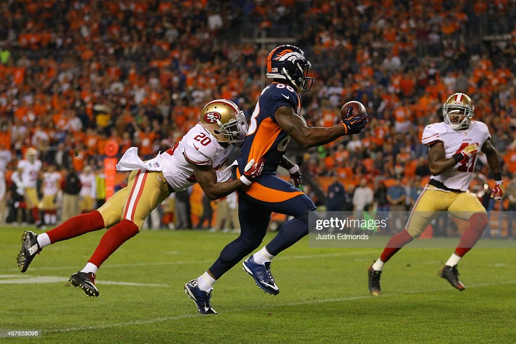Wide receiver Demaryius Thomas #88 of the Denver Broncos catches a pass for a third quarter touchdown under coverage by cornerback Perrish Cox #20 and strong safety Antoine Bethea #41 of the San Francisco 49ers at Sports Authority Field at Mile High on October 19, 2014 in Denver, Colorado.