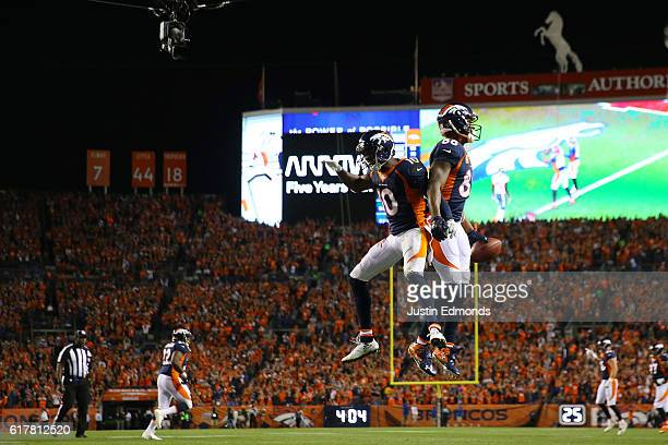 Wide receiver Demaryius Thomas of the Denver Broncos celebrate a touchdown with wide receiver Emmanuel Sanders in the second quarter of the game...