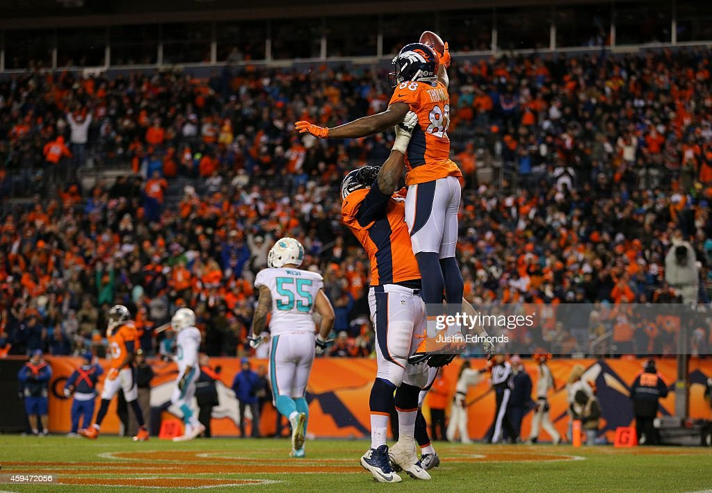 Wide receiver Demaryius Thomas #88 of the Denver Broncos celebrates a 5-yard third quarter touchdown catch, his third of the night, against the Miami Dolphins during a game at Sports Authority Field at Mile High on November 23, 2014 in Denver, Colorado.