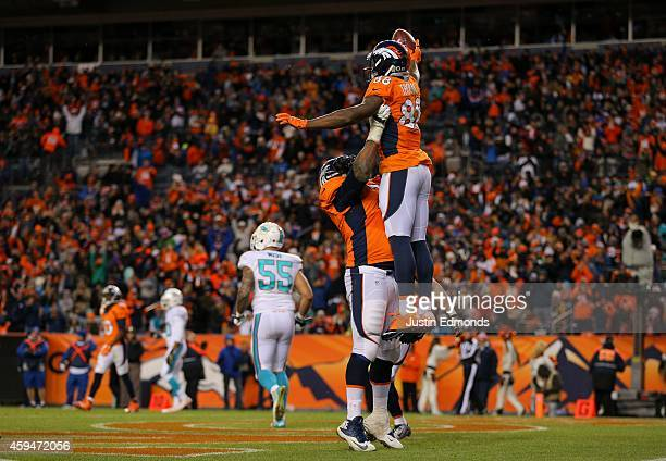 Wide receiver Demaryius Thomas of the Denver Broncos celebrates a 5yard third quarter touchdown catch his third of the night against the Miami...