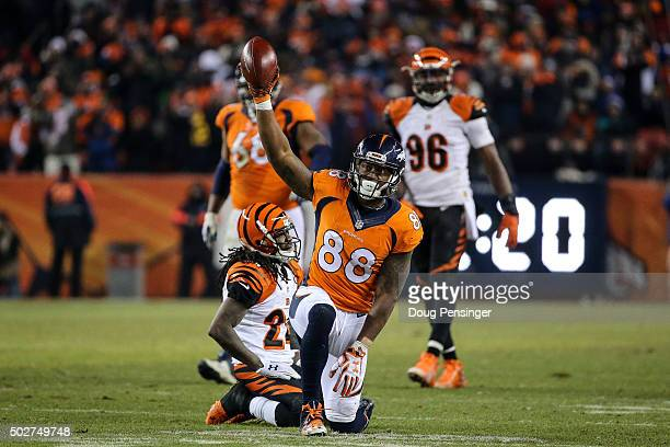 Wide receiver Demaryius Thomas of the Denver Broncos celebrates and cornerback Adam Jones of the Cincinnati Bengals reacts after Thomas caught a 12...