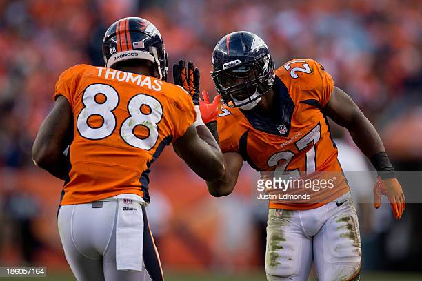 Wide receiver Demaryius Thomas of the Denver Broncos celebrates his fourth quarter touchdown with running back Knowshon Moreno against the Washington...