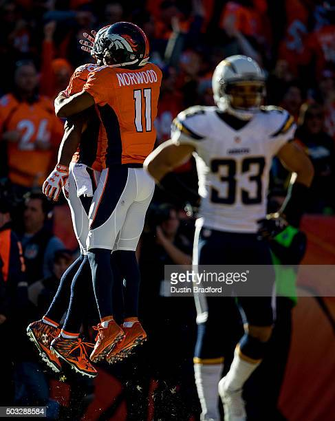 Wide receiver Demaryius Thomas of the Denver Broncos celebrates with wide receiver Jordan Norwood after scoring on a 72 yard touchdown reception in...