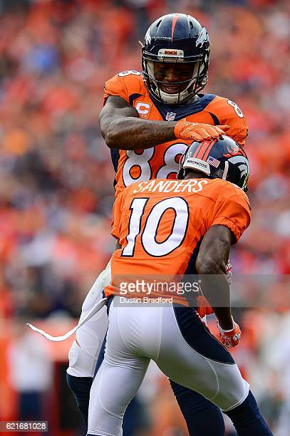 Wide receiver Demaryius Thomas of the Denver Broncos celebrates with wide receiver Emmanuel Sanders after a 37yard Sanders reception in the second...