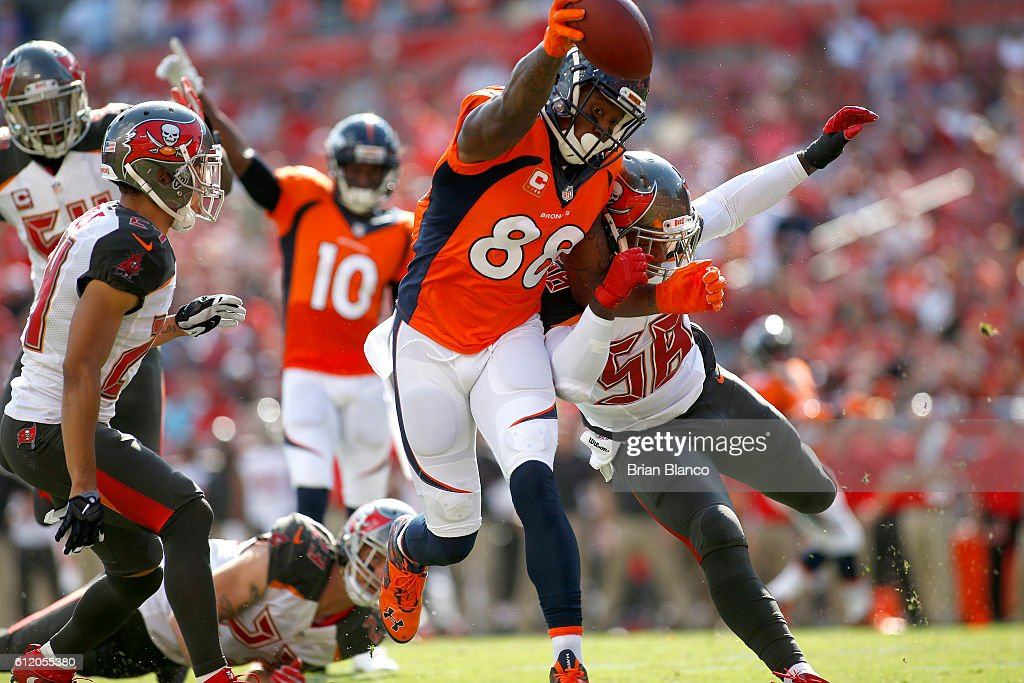 Wide receiver Demaryius Thomas #88 of the Denver Broncos fends off middle linebacker Kwon Alexander #58 of the Tampa Bay Buccaneers as crosses the goal line for a touchdown during the first quarter of an NFL game on October 2, 2016 at Raymond James Stadium in Tampa, Florida.