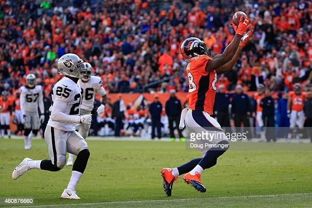 Wide receiver Demaryius Thomas of the Denver Broncos has a 23 yard reception before being tackled at the 1-yard line by cornerback D.J. Hayden of the...