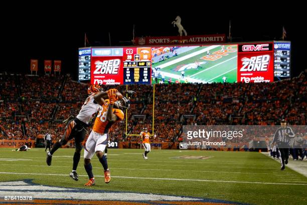 Wide receiver Demaryius Thomas of the Denver Broncos has a fourth quarter touchdown catch under coverage by cornerback Dre Kirkpatrick of the...