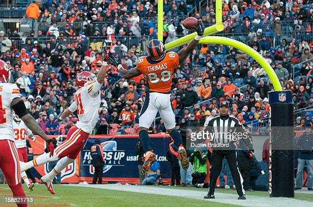 Wide receiver Demaryius Thomas of the Denver Broncos hauls in an acrobatic touchdown reception under coverage by cornerback Javier Arenas of the...