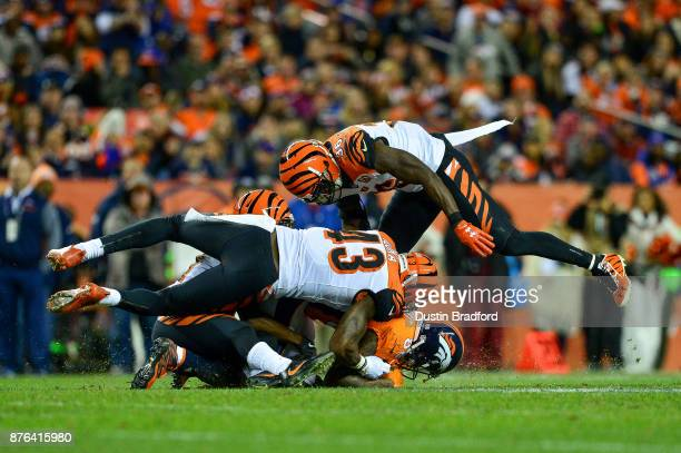 Wide receiver Demaryius Thomas of the Denver Broncos is hit by a trio of Cincinnati Bengals defensive players including George Iloka and Shawn...
