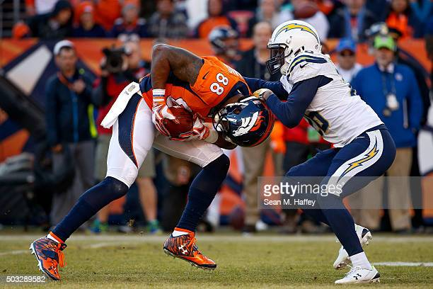 Wide receiver Demaryius Thomas of the Denver Broncos is tackled by cornerback Patrick Robinson of the San Diego Chargers after a 14 yard reception...