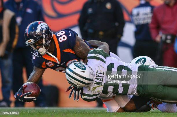 Wide receiver Demaryius Thomas of the Denver Broncos is tackled by free safety Marcus Maye of the New York Jets in the first quarter at Sports...