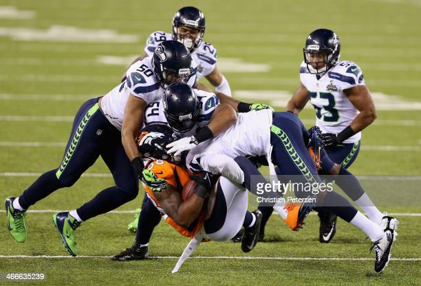 Wide receiver Demaryius Thomas of the Denver Broncos is tackled during Super Bowl XLVIII against the Seattle Seahawks at MetLife Stadium on February...