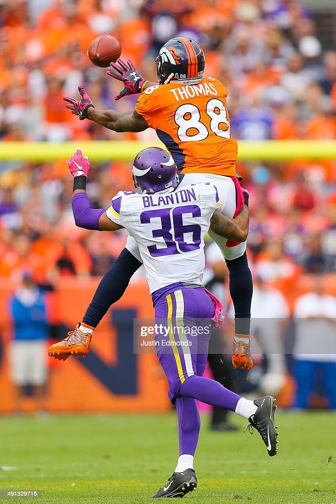 Wide receiver Demaryius Thomas #88 of the Denver Broncos leaps to make a catch under coverage by strong safety Robert Blanton #36 of the Minnesota Vikings during a game at Sports Authority Field at Mile High on October 4, 2015 in Denver, Colorado.