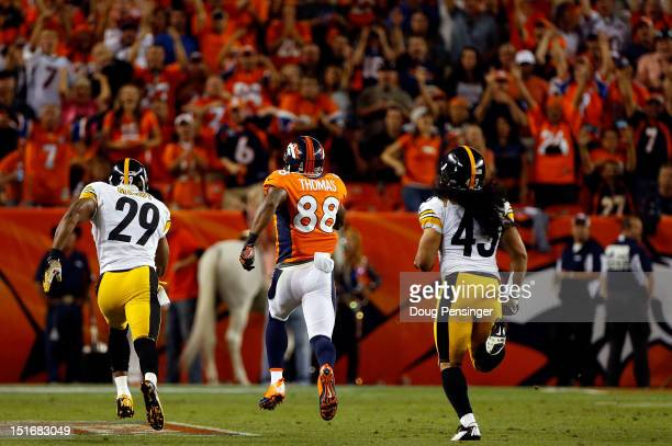 Wide receiver Demaryius Thomas of the Denver Broncos makes a 71 yard reception for a touchdown as free safety Ryan Mundy and strong safety Troy...