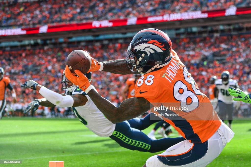 Wide receiver Demaryius Thomas #88 of the Denver Broncos makes a catch on the edge of the end zone for a fourth quarter touchdown against the Seattle Seahawks at Broncos Stadium at Mile High on September 9, 2018 in Denver, Colorado.