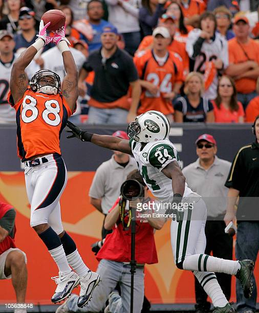 Wide receiver Demaryius Thomas of the Denver Broncos makes a reception for a touchdown against cornerback Darrelle Revis the New York Jets at INVESCO...